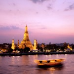 Wat Arun across Chao Phraya River during sunset