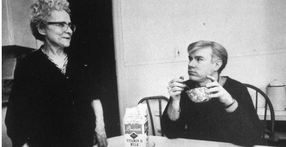 Andy Warhol eating cereal and looking at his mother, Julia